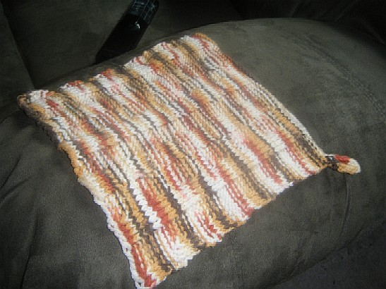 Washcloth/potholder with loop for hanging